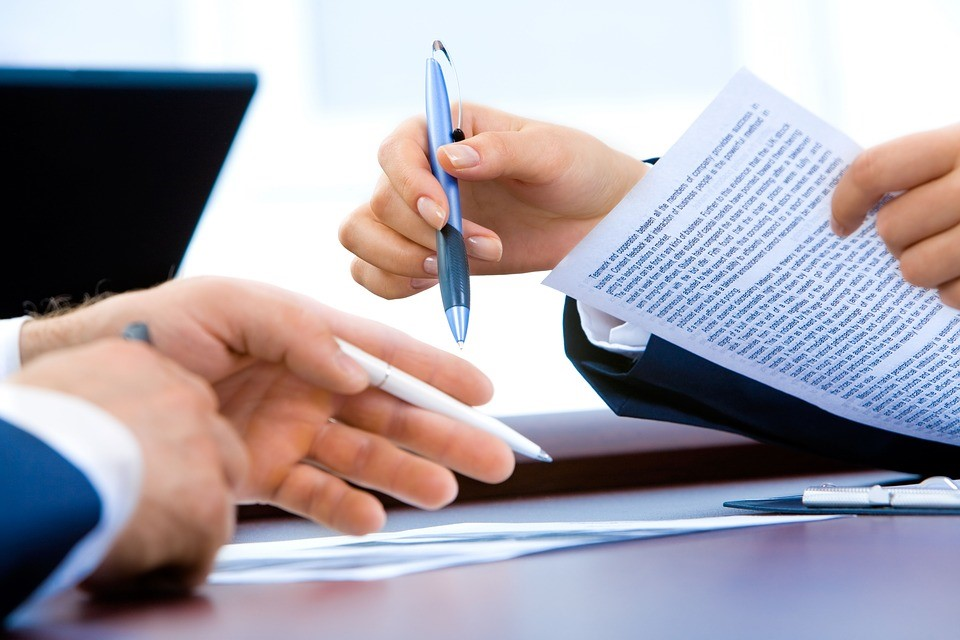 a mediator going over the mediation agreement with a client