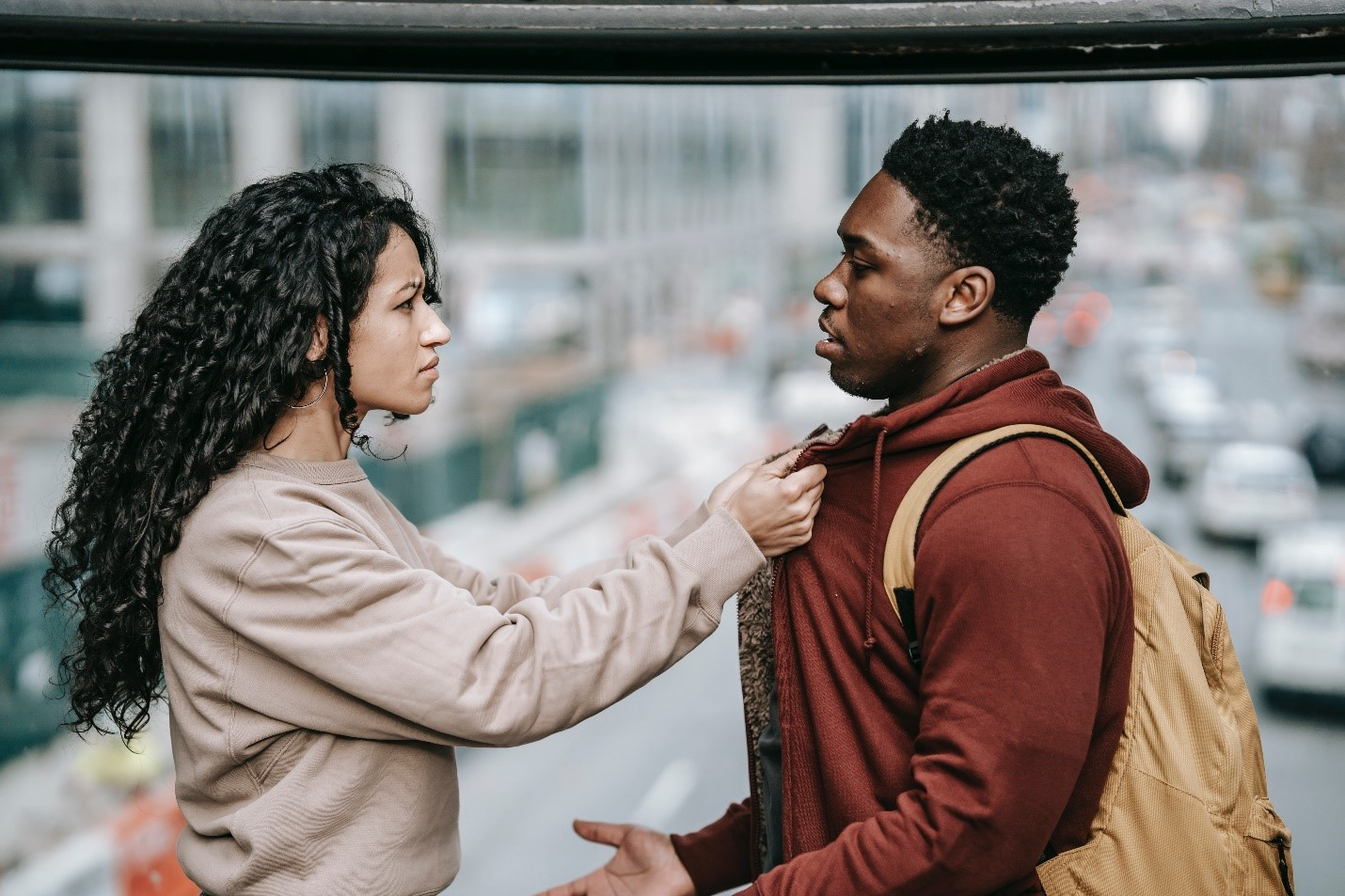 A couple having a conflict on the street